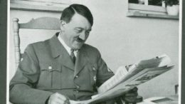 0Hitler-smiles-while-reading-newspaper-300x219